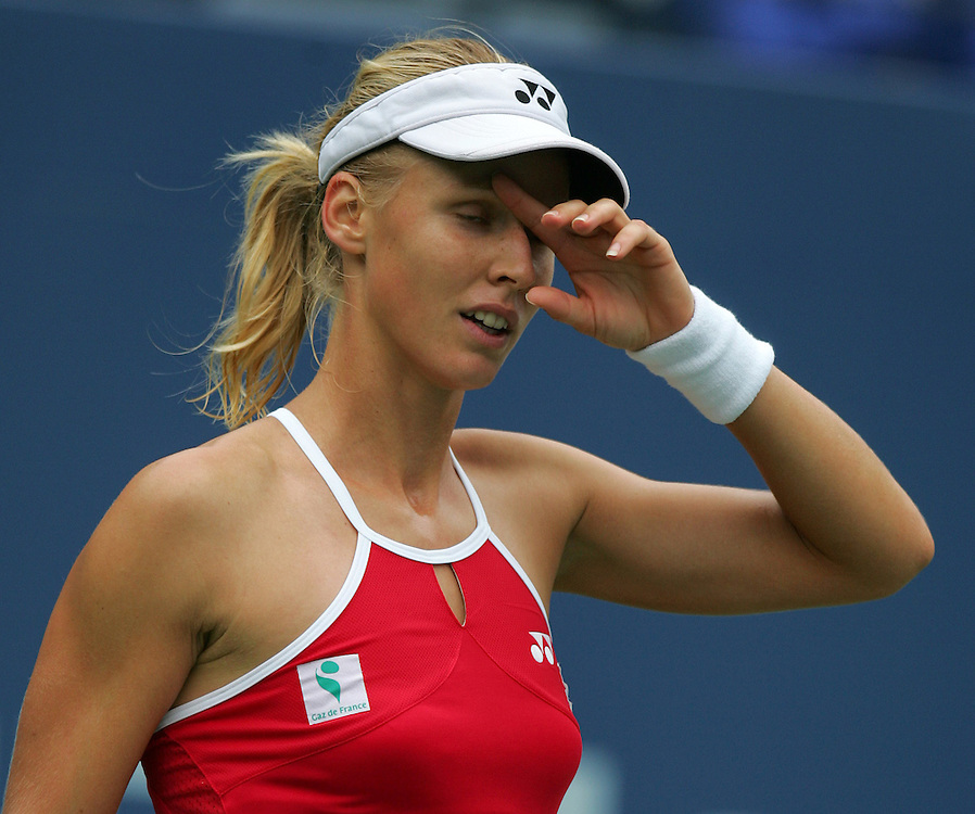 Elena Dementieva of Russia reacts while playing Jelena Jankovic of Serbia and Montenegro during their quarterfinals round match on the fourth day of the 2006 US Open tennis tournament in Flushing Meadows, New York Tuesday, 05 September 2006.
