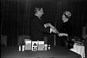 """17/12/1962<br /> 12/17/1962<br /> 17 December 1962<br /> Presentation of Packaging Awards at the Shelbourne Hotel, Dublin. Leo (Ireland) Ltd. had won the """"Eurostar"""" international award for packaging. Picture shows Mr. W.H. Walsh, General Manager of Coras Tractala and chairman of the Irish Packaging Institute, presenting the certificate for designing the winning pack to Mrs R. Walker, Manager of Signa Design Consultants."""
