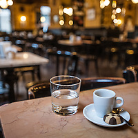 A small cup of coffee, a chocolate biscuit and mineral water at Caffe San Marco in Trieste, Italy.