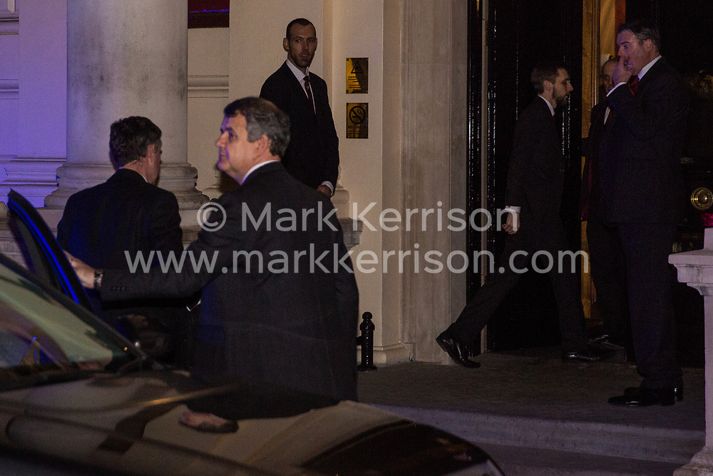 London, UK. 12th February, 2019. Justice Secretary David Gauke arrives to host a reception at the Gadson Club in Pall Mall whilst members and supporters of grassroots trade union United Voices of the World protest outside against his refusal to negotiate with the trade union over their demands for the London Living Wage, annual leave and sick pay for outsourced cleaners, security guards and receptionists working at the Ministry of Justice, all of whom have been on strike for varying periods recently. The Gadson Club is the official alumni club for the Oxford University Conservative Association.