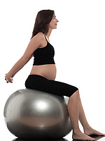 pregnant caucasian woman stretching on fitness ball isolated studio on white background