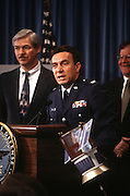 Colonel Pedro Ruston, Director of the National Reconnaissance Office's Small Satellite Program announces the discovery of water on the surface of the moon December 3, 1996 at the Pentagon. Dr. Dwight Duston (L) of Lawrence Livermore Laboratory looks on.