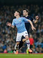 Football - 2019 / 2020 Premier League - Manchester City vs. Everton<br /> <br /> Phil Foden of Manchester City waits for the through ball with Seamus Coleman of Everton challenging, at The Etihad Stadium.<br /> <br /> COLORSPORT/ALAN MARTIN