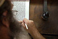 A Jewish resident of Hebron transcribes the Torah by hand for use in prayer and synagogues. It takes approximately ten months to transcribe the entire text of the Torah..Hebron, Israel. 07/11/2007.Photo © J.B. Russell/Blue Press