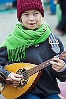 Portrait of a girl playing mandolin, Whidbey Island, Washington.