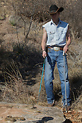 Sweetwater, TX - March 15: A snake hunters prepares to capture a western diamondback rattlesnake during a snake hunting demonstration at the 51st Annual Sweetwater Texas Rattlesnake Round-Up, March 15, 2009 in Sweetwater, TX. During the three-day event approximately 10,000 rattlesnakes will be collected, milked and served to support charity.   (Photo by Richard Ellis/Getty Images)