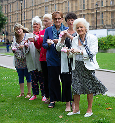 'Knitting nans' form a knit-in outside Parliament for equal parenting group Fathers4Justice, to lobby for separated fathers to have greater access to their children. The nans are taking a stand to say 'balls to a fatherless Father's Day'. <br />  London, June 04 2018.