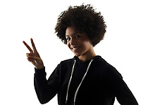 one mixed race african young teenager girl woman peace sign gesture in studio shadow silhouette isolated on white background