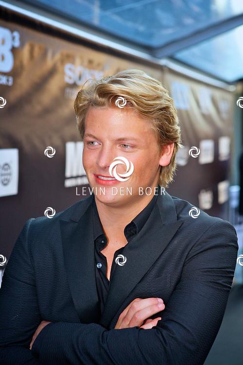 AMSTERDAM - Galapremiere van de nieuwe 3D bioscoopfilm MEN IN BLACK 3 in Pathe Tuschinski.  Met op de foto zanger Thomas Berge. FOTO LEVIN DEN BOER - PERSFOTO.NU