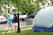 Brenda Swedlove (left) and Benjamin Swedlove pass by a tent as they participate in the Great American Campout Saturday June 27, 2015 in Middletown Twp., Pennsylvania. . (Photo by William Thomas Cain)