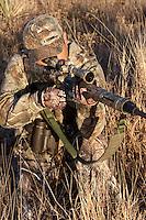 HUNTER SHOOTING A REMINGTON R-15 RIFLE REALTREE AP CAMO
