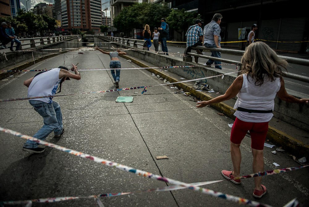 CARACAS, VENEZUELA - JULY 27, 2017: A road blocked by protesters, in support of a national strike, called by the political opposition to last for  48 hours, all day July 26th and 27th. They called for their supporters to close businesses, not go to work, and instead create barricades to block off their streets.  Opposition controlled areas of the country were completely shut down.  The strike was called as part of the opposition's civil resistance movement - that began on April 1st, to protest against the Socialist government's attempt to elect a new constituent assembly that will have the power to re-write the constitution, and will threaten democracy.  PHOTO: Meridith Kohut for The New York Times