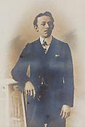 fading portrait man standing 1900s