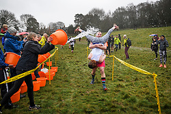 © Licensed to London News Pictures. 03/03/2019. Dorking, UK. Water is thrown over competitors as they take part in the 2019 annual Wife Carrying Race in Dorking, Surrey. Run over a course of 380m, with both men and women carry a 'wife' over obstacles, the race is believed to have originated in the UK over twelve centuries ago when Viking raiders rampaged into the northeast coast of England carrying off any unwilling local women . Photo credit: Ben Cawthra/LNP