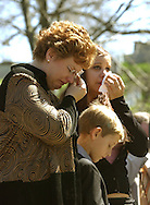 CAPTION: (Washington, D.C. 4/5/2005) Birgit Smith (cq) weeps beside her son David Smith (cq), 11, and daughter Jessica Smith (cq), 18, during a ceremony for the unveiling of a headstone for her husband, Medal of Honor recipient Sgt. 1st Class Paul R. Smith, at Arlington National Cemetery in Washington, D.C. Tuesday (4/5/05). .