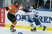 RIT forward Mark Logan and Air Force defenseman Jonathan Kopacka compete during the Atlantic Hockey semifinal at the Blue Cross Arena at the War Memorial in Rochester on Friday, March 18, 2016.