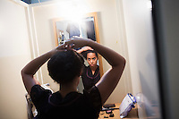 SLIEMA, MALTA - 8 FEBRUARY 2016: Actress Amanda Wilkin prepares herself in the dressing room before peforming in the touring Hamlet, performed by the Shakespeare's Globe theatre company, at the Salesian Theatre in Sliema, Malta, on February 8th 2016.<br /> <br /> The touring Hamlet, performed by the Shakespeare's Globe theatre company, is part of the Globe to Globe tour that set off in April 2014 (on the 450th anniversary of Shakespeare's birth) with the ambitious intention of visiting every country in the world over 2 years. The crew is composed of a total of sixteen men and women: four stage managers and twelve twelve actors  actors perform over two dozen parts on a stripped-down wooden stage. So far Hamlet has been performed in over 150 countries, to more than 100,000 people and travelled over 150,000 miles. The tour was granted UNESCO patronage for its engagement with local communities and its promotion of cultural education. Hamlet was also played for many dsiplaced people around the world. It was performed in the Zaatari camp on the border between Syria and Jordan, for Central African Republic refugees in Cameroon, and for Yemeni people in Djibouti. On February 3rd it was performed to about 300 refugees in Calais at the camp known as the Jungle.