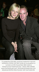 TV presenter ZOE BALL and her husband musician NORMAN COOK (FAT BOY SLIM) at a reception in London on 8th November 2001.OUA 6