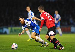 Bristol Rovers' Stuart Sinclair challenges Kidderminster Harriers's Kevin Nicholson - Photo mandatory by-line: Neil Brookman/JMP - Mobile: 07966 386802 - 15/11/2014 - SPORT - Football - Bristol - Memorial Stadium - Bristol Rovers v Kidderminster - Vanarama Football Conference