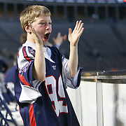 A young fan of the Boston Cannons celebrates a Cannons win following the game at Harvard Stadium on May 17, 2014 in Boston, Massachuttes. (Photo by Elan Kawesch)