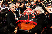 Members of Victor Jara`s family, Joan Turner Jara in the back carry jara`s coffin. <br /> After 36 years, Chile's most popular folk singer, Victor Jara was mourned and buried. About 10.000 people attended to his vigil and funeral. Victor Jara was assassinated on September 15 1973 by Pinochet`s military officials of at least 43 gunshots and massive beatings. His 1973 funeral had to be made in private because of military restrictions.
