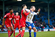 Swindon Town defender Raphael Rossi Branco (29) battles with Bury forward Tom Pope (11)  during the EFL Sky Bet League 1 match between Bury and Swindon Town at the JD Stadium, Bury, England on 11 February 2017. Photo by Simon Davies.