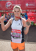 Amy Guy, former Miss World Sport & Fitness, formerly 'Siren' in Gladiators at the end of the Virgin Money London Marathon 2014 on Sunday 13 April 2014<br /> Photo: Roger Allan/Virgin Money London Marathon<br /> media@london-marathon.co.uk
