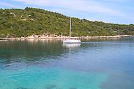 A sailboat passing through emerald coloured<br /> sea between the islands of Korcula and<br /> Badija on the Dalmatian Coast of Croatia<br /> c. Ellen Rooney