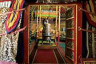Mongolia. Ulaanbaatar. Palace of Bogdo Khan (last king of Mongolia), The royal yurt (ger) in the winter palace  Oulan Bator Ulan Baatar   Mongolia      /  palais du Bogdo Khan, (dernier roi de Mongolie). La yourte royale dans le palais d'hiver  Oulan Bator Ulan Baatar   Mongolie Interieure de la yourte (ger) souveraine du dernier theocrate [Debut du XXème]. Palais-musee du Bogdo  Gegen, Oulan Bator  MongolieLors de ses deplacements, le souverain utilisait cette somptueuse yourte, richement sculptee et decoree aux tons de rouge et d'or, avec son mobilier precieux et sa vaisselle d'argent. A gauche du lit, un autel portatif avec des statuettes en bronze dore à l'or; à droite son trône de campagne. L'exterieur de la yourte est recouverte de peaux de lynx des neiges, animal aujourd'hui protege.   /  L0006044   /  R20023/