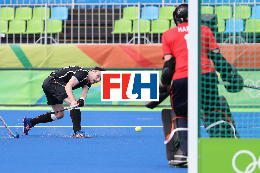 RIO DE JANEIRO, BRAZIL - AUGUST 09:  Christopher Ruhr #17 of Germany takes a shot on goalkeeper David Harte #1 of Ireland during the hockey game on Day 4 of the Rio 2016 Olympic Games at the Olympic Hockey Centre on August 9, 2016 in Rio de Janeiro, Brazil.  (Photo by Christian Petersen/Getty Images)
