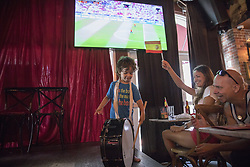 July 1, 2018 - Miami Beach, FL, USA - Samuel Valdes, 2, plays a drum on stage at Tapas and Tintos, a restaurant in Miami Beach, Fla. where fans gathered to watch Spain take on Russia during the 2018 FIFA World Cup Round of 16 knockout stage on Sunday, July 1, 2018. After the score being tied 1-1 at the end of extra time, Russia won, 4 penalty kicks to 3. (Credit Image: © Ellis Rua/TNS via ZUMA Wire)
