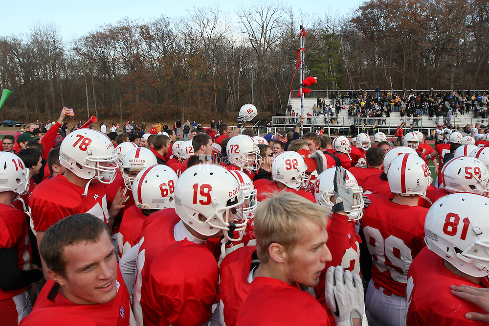SJU celebrates the victory on the field. Credit: Brace Hemmelgarn-Saint John's University