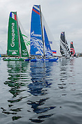 Groupama, Gazprom, Emirates Team New Zealand and Alinghi, day three of the Cardiff Extreme Sailing Series Regatta. 24/8/2014