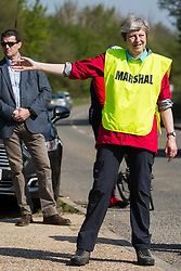 Maidenhead, UK. 19th April, 2019. Prime Minister Theresa May acts as a marshal at the annual Maidenhead Easter 10 charity race on Good Friday.