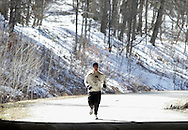 Mamakating, New York - A man approaches a tunnel during the Wurtsboro Mountain 30K road race on March 20, 2011.