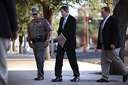 "Texas Rangers escort polygamist leader Warren Jeffs, who heads the Fundamentalist Church of Jesus Christ of Latter-Day Saints, to his sentencing hearing in San Angelo, Texas, Aug. 9, 2011. Jeffs  was sentenced to life in prison for sexually assaulting two underage girls he claimed as ""spiritual"" brides. The Texas jury of ten women and two men deliberated for less than an hour before giving him a life sentence for one charge and 20 years for a second, the maximum sentence for both."
