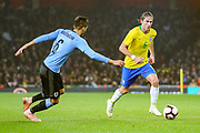 Uruguay midfielder Rodrigo Bentancur (6) and Brazil defender Filipe Luis (6) during the Friendly International match between Brazil and Uruguay at the Emirates Stadium, London, England on 16 November 2018.