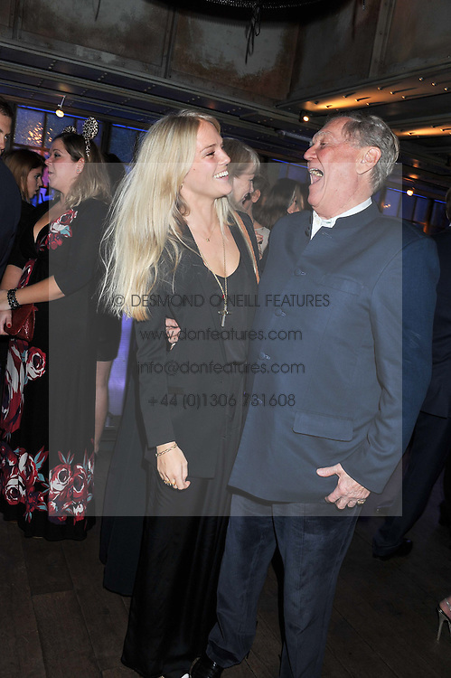 LADY NATASHA HOWARD and her father The 21st EARL OF SUFFOLK at the Wild for WSPA dinner in aid of the charity World Society for the Protection of Animals held at Under The Bridge, Stamford Bridge, Fulham Road, London on 23rd February 2012.