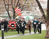 """Members of the Meredith Fire Department followed by family and friends depart Hesky Park following the memorial service for retired Chief Charles """"Chuck"""" Palm Sunday afternoon.   (Karen Bobotas/for the Laconia Daily Sun)"""