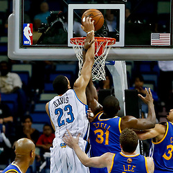 Mar 18, 2013; New Orleans, LA, USA; New Orleans Hornets power forward Anthony Davis (23) dunks over Golden State Warriors center Festus Ezeli (31) during the second half of a game at the New Orleans Arena. The Warriors defeated the Hornets 93-72.  Mandatory Credit: Derick E. Hingle-USA TODAY Sports