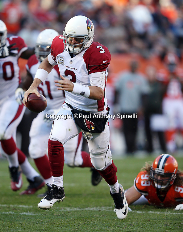 Arizona Cardinals quarterback Carson Palmer (3) runs for a fourth quarter touchdown that gets reviewed and reversed, marked short of the goal line during the 2015 week 8 regular season NFL football game against the Cleveland Browns on Sunday, Nov. 1, 2015 in Cleveland. The Cardinals won the game 34-20. (©Paul Anthony Spinelli)