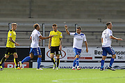 Celebrations as Bury FC striker Hallam Hope (24) scores Bury's first goal during the EFL Cup match between Burton Albion and Bury at the Pirelli Stadium, Burton upon Trent, England on 10 August 2016. Photo by Aaron  Lupton.