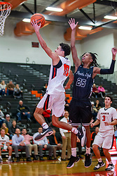 20 December 2019: Boys Basketball game between the Peoria High Lions and the Normal Community Ironmen in Normal Community High School, Normal IL