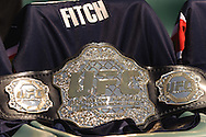 SYDNEY, AUSTRALIA, FEBRUARY 24, 2011: A UFC title belt is placed atop a custom Sydney Roosters jersey made for fighter Jon Fitch (not pictured) during a media event at Sydney Football Stadium in Sydney, Australia on February 24, 2011
