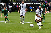 Football - 2019 / 2020 Championship - Swansea City vs Sheffield Wednesday<br /> <br /> André Ayew of Swansea City scores his team's second goal from a penalty<br /> in a match played with no crowd due to Covid 19 coronavirus emergency regulations, at the almost empty Liberty Stadium.<br /> <br /> COLORSPORT/WINSTON BYNORTH