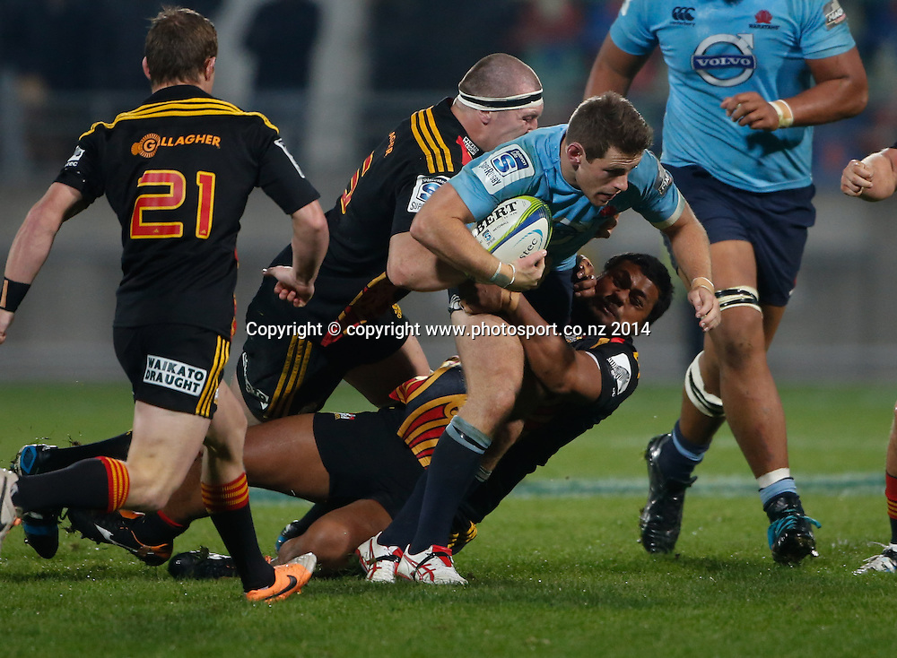 Waratahs Bernard Foley breaks a tackle. Super Rugby, Chiefs v Waratahs, Yarrow Stadium, New Plymouth, New Zealand. Saturday, 31 May, 2014. Photo: John Cowpland / photosport.co.nz