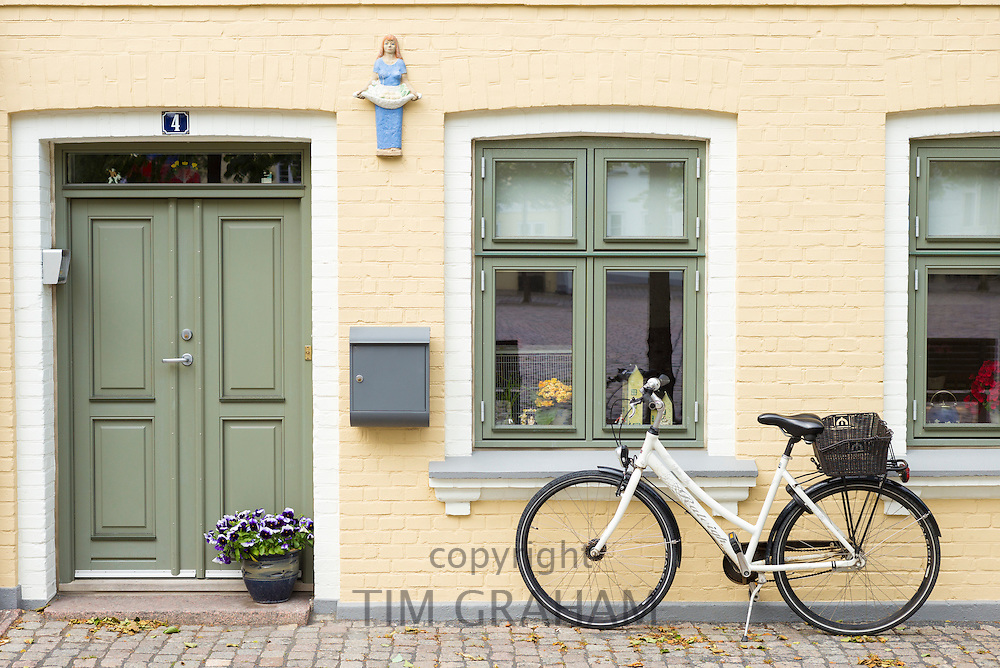Painted house and bicycle in Sortebrodre Torvet in the old town in Odense on Funen Island, Denmark