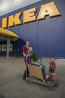 """I would like to open an environmentally friendly kid's boutique.""   -Cassandra Frantz with her daughters, Vaughn and Noemi,  outside the IKEA in Emeryville, CA"