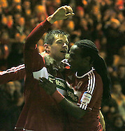 Picture by Paul Gaythorpe/Focus Images Ltd +447771 871632.26/12/2012.Marvin Emnes (r) congratulates Lucas Jutkiewicz (l) of Middlesbrough on scoring the winning goal against of Blackburn Rovers during the npower Championship match at the Riverside Stadium, Middlesbrough.
