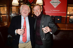 Left to right, PETER GRUNDY and HENRY KELLY at the Tabasco British Oyster Opening Championship 2013 at J Sheekeys, 28-35 St. Martins Court, London on 9th September 2013.